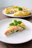 Homemade Spinach and Bacon Egg Quiche in a pie crust on wood board. French cuisine flat design Stock Photos