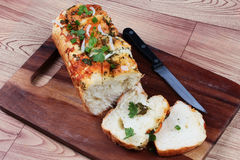 Homemade spinach bread with halves onion and cashew nuts on butcher served Stock Photo