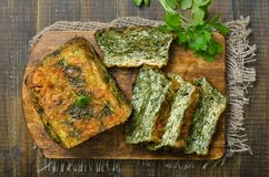 Homemade spinach bread. On wooden board, top view Royalty Free Stock Image