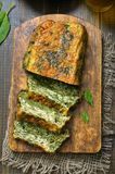 Homemade spinach bread. On wooden board, top view Royalty Free Stock Images