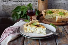 Homemade spinach, chard and nettle quiche. Freshly baked pie with feta cheese. Healthy food concept. Savory pastry. stock photo