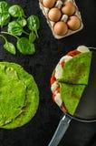 Homemade spinach crepes Stock Photos