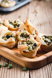 Homemade spinach and feta cheese puff pastry cups Royalty Free Stock Image