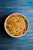 Homemade spinach french pie quiche lorraine on wooden board. With place foe text Royalty Free Stock Photography