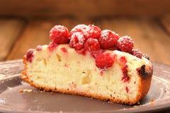 Homemade sponge cake with fresh juicy wild raspberries and icing Royalty Free Stock Photos