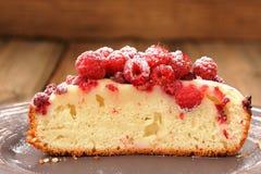 Homemade sponge cake with fresh juicy wild raspberries and icing Stock Image