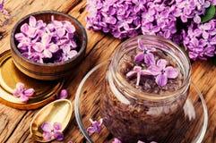 Healing lilac flower jam. Homemade spring jam of lilac petals. Medicinal jam stock photography