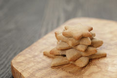 Homemade star shape ginger cookies on olive board Royalty Free Stock Images