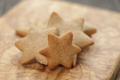 Homemade star shape ginger cookies on olive board Stock Images