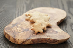Homemade star shape ginger cookies on olive board Royalty Free Stock Photography