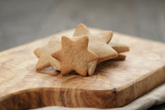 Homemade star shape ginger cookies on olive board Stock Photo