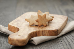Homemade star shape ginger cookies on olive board Stock Image