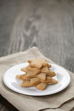 Homemade  star shape ginger cookies on wood table Royalty Free Stock Image