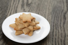 Homemade star shape ginger cookies on wood table Stock Images