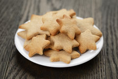 Homemade star shape ginger cookies on wood table Stock Image
