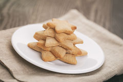 Homemade  star shape ginger cookies on wood table Royalty Free Stock Photo