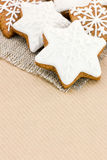 Homemade star shaped christmas gingerbread cookies on brown pape Stock Images