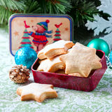 Homemade star shaped cookies on a wooden background. Christmas decoration. Selective focus Royalty Free Stock Photography