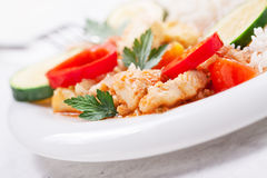 Homemade stewed fish with vegetables and rice, closeup Stock Images