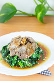 Homemade stir fried spinach with coconut butter, garlic, soy sauce Stock Photo