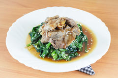 Homemade stir fried spinach, meat with coconut butter, garlic, soy sauce Stock Image