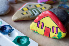 Homemade stone painted as yellow home. And palette Royalty Free Stock Photography