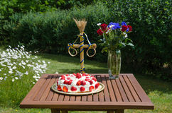 Homemade strawberry cake on decorated table in garden Stock Images