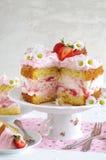 Homemade strawberry cake with fresh cheese cream Stock Images