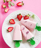 Homemade strawberry ice cream. With fresh berries stock image