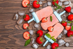 Homemade strawberry ice cream or popsicles Stock Images