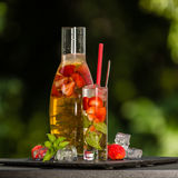 Homemade strawberry ice tea in the garden Stock Photography