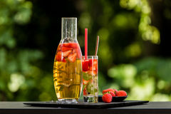 Homemade strawberry ice tea in the garden Stock Photo