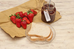 Homemade strawberry jam. And bread Royalty Free Stock Photos