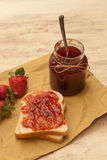 Homemade strawberry jam. And bread Stock Photos