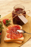 Homemade strawberry jam. And bread Stock Images