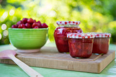 Homemade strawberry jam in different jars and fresh ripe strawbe Royalty Free Stock Photography