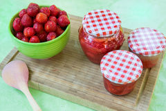 Homemade strawberry jam in different jars and fresh ripe strawbe Stock Images