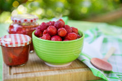 Homemade strawberry jam in different jars and fresh ripe strawbe Stock Photography