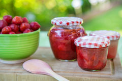 Homemade strawberry jam in different jars and fresh ripe strawbe Stock Photo