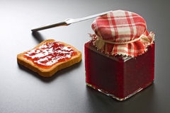 Strawberry Jam Jar, Rusk and Knife Royalty Free Stock Photography