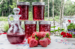 Homemade strawberry jelly and syrup royalty free stock photography