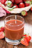 Homemade Strawberry Juice. And fresh fruits on dark wooden background Royalty Free Stock Image