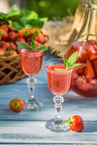 Homemade strawberry liqueur Stock Images