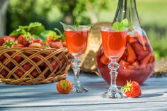 Homemade strawberry liqueur served in the garden Stock Image