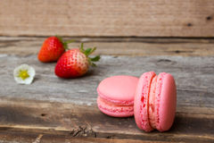 Homemade strawberry macaroons on wooden background. Stock Image