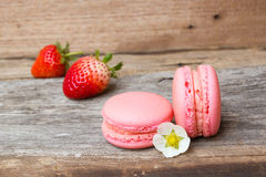 Homemade strawberry macaroons on wooden background. Stock Photography