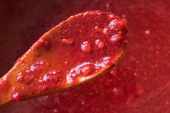 Homemade strawberry marmalade (jam) top view texture, red background Stock Photos