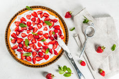 Homemade strawberry pie. Homemade biscuit cake with whipped cream, fresh organic raw strawberries and mint. On a white stone table. Copy space top view Stock Photos