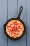 Homemade strawberry pie with fresh strawberries in cast iron ski stock image