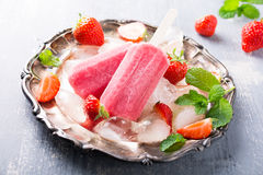 Homemade strawberry popsicles Stock Images